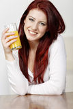 Happy woman with fresh Orange juice Royalty Free Stock Photo