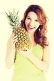 Happy woman with fresh pineapple fruit Stock Image