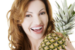 Happy woman with fresh pineapple fruit Royalty Free Stock Photos
