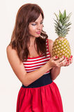 Happy woman with fresh pineapple fruit Royalty Free Stock Photography