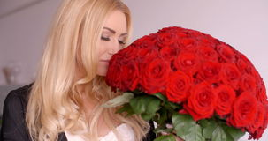 Happy Woman with Fresh Red Rose Flower Bouquet stock footage