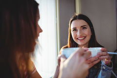 Happy woman with friend at cafeteria royalty free stock photos
