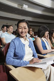 Happy Woman With Friends In Classroom Stock Photo