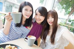 Happy woman friends in restaurant Stock Photo