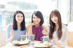 Happy woman friends in restaurant Stock Images