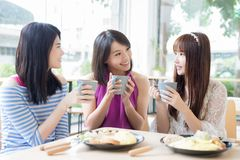 Happy woman friends in restaurant Stock Image