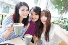 Happy woman friends in restaurant Stock Image