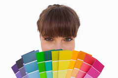 Happy woman with fringe showing colour charts close up Royalty Free Stock Images