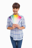 Happy woman with fringe showing colour charts Stock Images