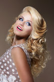 Happy Woman with Frizzy Blond Hairs Looking Up royalty free stock photos