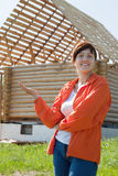 Happy  woman  in front of building residence Royalty Free Stock Photo