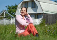 Happy woman in front of  home Stock Photos