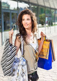Happy woman in front of a shopping center Royalty Free Stock Images