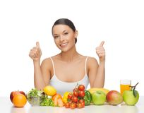 Happy woman with fruits and vegetables Stock Photos