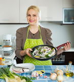Happy woman with frying pan Royalty Free Stock Photo