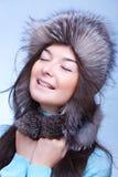 Happy woman in fur cap Stock Photos