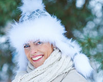 Happy woman with fur cap in winter Stock Photography