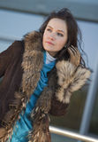 Happy woman in fur coat Royalty Free Stock Photos