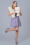 Happy woman in gala dress holding present boxes Stock Images