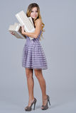 Happy woman in gala dress holding present boxes Royalty Free Stock Photography