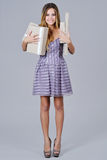 Happy woman in gala dress holding present boxes Royalty Free Stock Photo