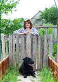 Happy woman in the garden with her labrador Royalty Free Stock Images