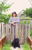Happy woman in the garden with her labrador dog Stock Photo
