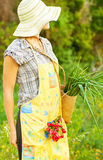 Happy woman gardener working Royalty Free Stock Photos