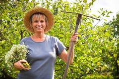 Happy woman gardening Stock Photography