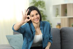 Happy Woman Gesturing Ok Sign At Home Stock Images