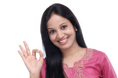 Happy woman gesturing OK sign Stock Images