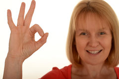 Happy woman gesturing okay Royalty Free Stock Photos