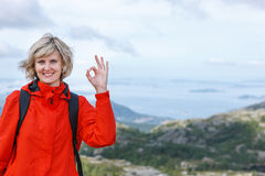 Happy woman gesturing thumbs up Stock Photography