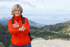 Happy woman gesturing thumbs up Royalty Free Stock Photos