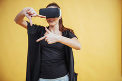 Happy woman gets experience of using VR-glasses virtual reality headset Stock Photo