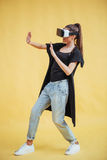 Happy woman gets experience of using VR-glasses virtual reality headset Royalty Free Stock Photo