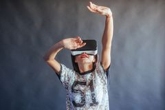 Happy woman gets experience of using VR-glasses virtual reality headset. Stock Images