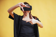 Happy woman gets experience of using VR-glasses virtual reality headset Stock Images