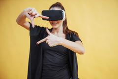Happy woman gets experience of using VR-glasses virtual reality headset Stock Photography