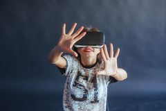 Happy woman gets experience of using VR-glasses virtual reality headset. Royalty Free Stock Image
