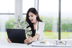 Happy woman gets fortune Stock Photography