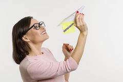 Happy woman gets rid of depression. Conceptual image with paper abstract airplane. Happy woman gets rid of depression. Conceptual image with a paper abstract Stock Image