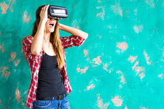 Happy woman getting experience using VR-headset glasses of virtual reality much gesticulating hands Stock Photography
