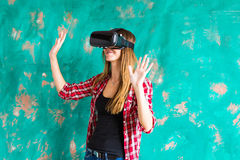 Happy woman getting experience using VR-headset glasses of virtual reality much gesticulating hands Stock Images