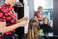 Happy Woman Getting Haircut In Beauty Salon Royalty Free Stock Images