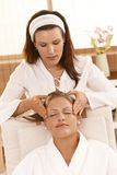 Happy woman getting head massage Stock Photo