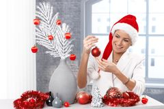 Happy woman getting ready for christmas royalty free stock photography
