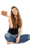 The happy woman with the gift Stock Photography