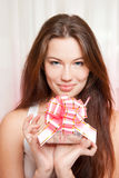 Happy woman with gift Royalty Free Stock Image