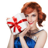 Happy woman with a gift Royalty Free Stock Image